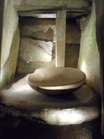 Photograph of bowl inside passage tomb chamber, Newgrange