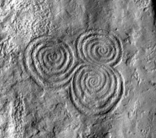 Detailed view of tri-spiral decoration on orthostat 10, Newgrange