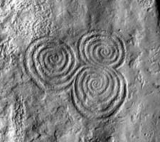Detailed view of tri-spiral decoration on orthostat 10, Newgrange
