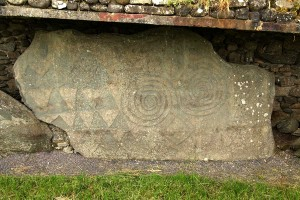 Photograph of decorated kerbstone 67, Newgrange