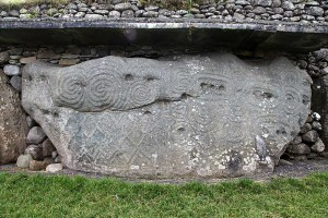 Photograph of the decorated kerbstone 52, Newgrange