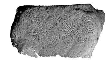 Shaded elevation image of decorated kerbstone 56, Knowth