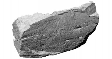 Perspective view of decorated kerbstone 52, Knowth