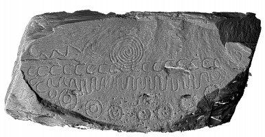 Shaded elevation image of decorated kerbstone 52, Knowth